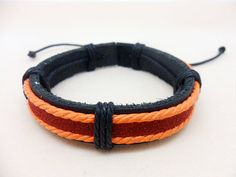 Shoply.com -Leather bracelet made of Orange and Black rope with black leather. Only $3.25