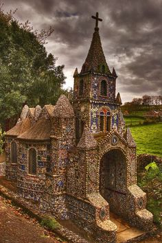 "Saint Andrew ""The Little Chapel"", decorated by broken pieces of colored glass, in a rural part of Guernsey, Channel Islands"