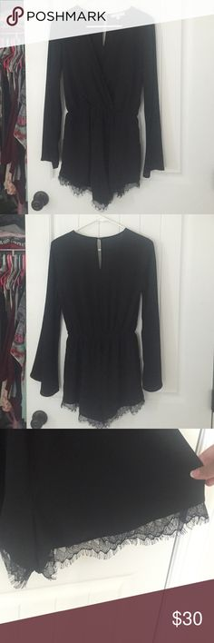Black long sleeve romper, worn once! Size M, brand is Illa Illa. Only worn once or twice. Really pretty lace along the bottom, with pockets, deep V neck, ROMPER not dress! Illa illa Dresses Long Sleeve