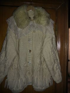Fur scarf with lace trim can be worn with any coat, cardigan, for example, with the bulk oversayz- jacket in the style of boho
