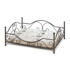 Does your pup or cat insist on world-class amenities at home and abroad? This bed will delight them with regal style and worldly pattern that features crowns and the Eiffel Tower. The iron bed frame features pretty flourishes and the neutral cushion will match any decor. Spot clean only. Super cute dog bed.    http://www.bonanza.com/booths/Gypsy_Junk_Wagon