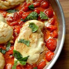 Balsamic Caprese Chicken Skillet combines fresh cherry tomatoes with butter, balsamic, and basil to create a delicious sauce!