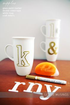 DIY Gold Monogram Mugs from le zoe musings (using glass paint marker and double-sided tape)