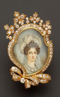 Antique 18kt Gold, Portrait Miniature, and Diamond Pendant/Brooch, Tiffany & Co., depicting the Duchesse d'Angouleme with plumes in her hair and wearing elaborate jewels, the shaped mount with floral and bow motifs, set with old European and old single-cut diamond melee, 1 1/8 x 1 3/4 in., signed and identified on the reverse,