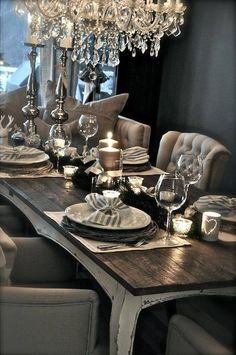 Beautiful, lavish chairs with reclaimed wood table and chandelier. Picture perfect elegance.