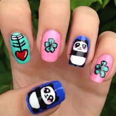 "<p>Via <a href=""http://nailartgallery.nailsmag.com/anna_dirks7/photo/449714/panda-nails"">Nail Art Gallery</a>.</p>"