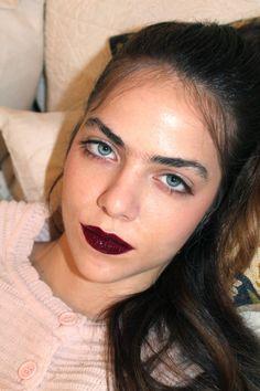 Baby Hairs And Dark Glossy Lips