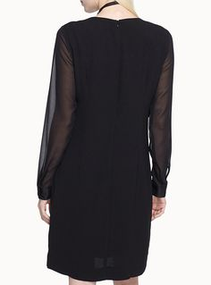 b.young at Icône   A chic twist on the classic little black dress featuring sheer, blouse-like voile sleeves   Rich and fluid crepe, satiny stretch knit lining   Hidden zip behind   Satiny buttoned cuffs    The model is wearing size 34    Length: 94cm, from the top of the shoulder