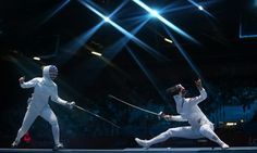 Susie Scanlan of US (L) approaches Injeong Choi of South Korea (R) during their Women's Fencing Epee Team Semi final match