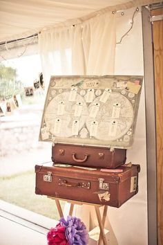 Table number display: vintage map and suitcases