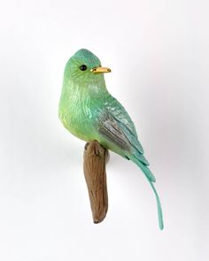 Long tailed Sylph (LC)  Here is another hummingbird that will be available on Friday.  The males have such ridiculous long tails in comparison to their bodies that it actually slows down their flight 😮  1 of 3 full bodied birds. Triple fired with real gold luster beak. Animal Sculptures, Luster, Hummingbird, Bodies, Friday, Birds, Gold, Animals, Animales