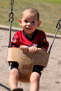 Suprise fathers day photo session. My son is wearing his daddy's favorite football team. Arizona cardinals
