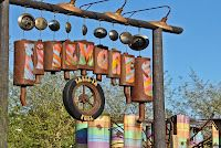 Filmore's snack and beverage stop is just past the sign on your right.  Filmore's Taste-In brought such a smile to my face; after all, it's just a place to grab a quick snack and something cool to drink, and yet the theming was so detailed that it becomes a mini-attraction in itself - much like all the stops in Cars Land!