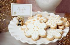 Gold Christmas party snowflake cookies!  See more party planning ideas at CatchMyParty.com!