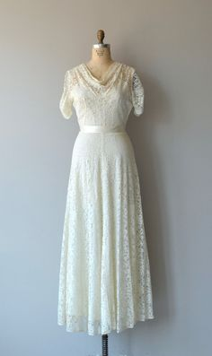Vintage 1930s cream lace wedding gown with lovely draped neckline, short sleeves, fitted waist, unattached rayon slip and metal side zipper.  --- M E