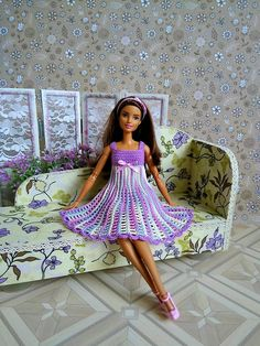 Wonderful rainbow dress shades of lilac Barbie crocheted. Sleeveless dress, easy to dress up for doll. It has a clasp on two small buttons. Decorated with satin bow. Doll and other accessories not included. Dear customer, the colors on your screen may vary slightly from the