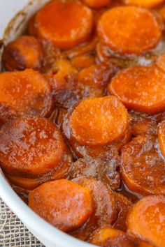 Candied Sweet Potatoes - An easy side dish recipe that tastes like a dessert. Tender sweet potato rounds are covered in a rich, buttery glaze. Candied Sweet Potatoes Mike Warfield Thanksgiving Candied Sweet Potatoes - An easy side dish reci Side Dishes Easy, Side Dish Recipes, Veggie Recipes Sides, Southern Side Dishes, Glazed Sweet Potatoes, Baked Sweet Potato Oven, Yam Sweet Potato, Best Sweet Potato Recipe, Cheese
