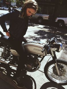 I really enjoy giving names and credit to these famous tumblr photos that have lost their original source- this is Jordan on her Honda CB200...