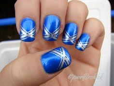 Bright blue nails with silver crossed accents