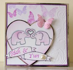 fizzi~jayne makes.... Wedding card. A custom order for Rich and Yun's wedding. The theme was pink and white with butterflies and they were getting married in a zoo. Elephants are hand drawn.