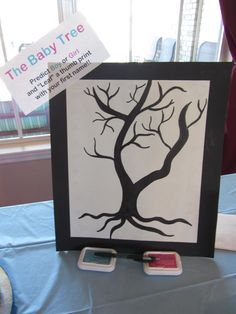 """Our Gender Reveal Party """"Baby Tree"""" thumbprints for vote casting."""