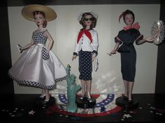 The Studio Commissary: July Dolls on Display: Hooray for the Red, White & Blue!...(12 PICS)  -  Posted by Megin in Portland [Email User] on July 1, 2016, 4:32 pm.  Here's the red, white and blue displays in the doll room. The patriots are celebrating on the long table while the guys and gals cheer on the troops from the shelves.