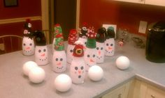 Snowman bowling made from coffee creamer bottles, socks, and styrofoam balls