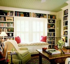 I ♥ the window seat, bead-board ceiling and, of course, the beautiful built-in book cases.