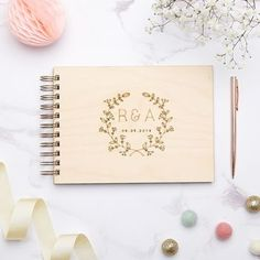 personalised floral laurel wedding guest book by owl & otter | notonthehighstreet.com