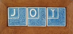 Three Framed Tile that spell JOY in blue and by FayJonesDayTile