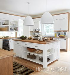 This space showcases the easiest and most effective styling tricks for an inviting kitchen.   Photographer: Virginia MacDonald Designer: Montana Burnett