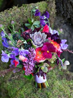Inspiration for this bouquet stemmed from the florist's love of fragrance and texture. Juxtaposing the soft, romantic and aromatic blooms of roses, lilac and sweet peas with the weird and wonderful textures of succulents, smoke bush, leucodtendron cones and ivy berry creates a unique and one-of-a-kind bouquet.