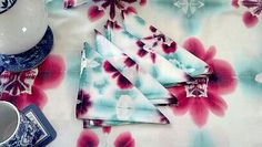 table cloth and napkins inspired by summer s flower garden full of icelandic poppies.