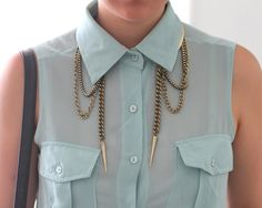 silk baby blue blouse with gold spike necklace