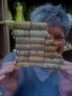My darling mom holding wine cork art in shape of Missouri state. Cute idea for all those wine corks.