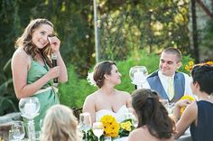 WEDDINGS – norrisphoto #norrisphoto - Speech speech speech! This maid of honor is rocking her green satin dress, as she gets a bit teary eyed while wishing the happy couple the best. Los Angeles professional photographer captures this beautiful outdoor reception.   #brideandgroomtable #outdoorreception #maidofhonorspeech
