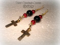 A beautiful pair of dangling red and black glass bead earrings adorned with 2 hand cut and hammered brass crosses   hanging from gold plated $13.65