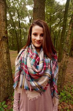 The blanket scarf is in this fall & winter. Here are 6 ways to style and wear your blanket scarf to dress up any outfit! Check it out at Dressing Space Boutique