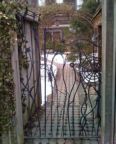 Concurrently whimsical and dark, this wrought iron gate in Cambridge, MA, feels like an entrance into a Tim Burton movie. Now if only Johnny Depp was behind it Garden Doors, Garden Fencing, Garden Art, Dream Garden, Fence, Metal Gates, Wrought Iron Gates, Gate Pictures, Entrance Gates
