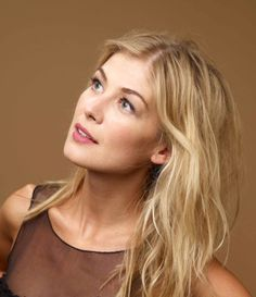 Rosamund Pike as Robin the counsellor/fairy godmother