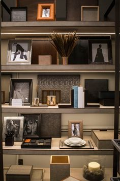 Shelves with luxury home accessories, photo frames and storage - The Simpsons London showroom at Chelsea Design centre showcasing luxury interior design, furniture and home accessories. Featured on www.martynwhitedesigns.com