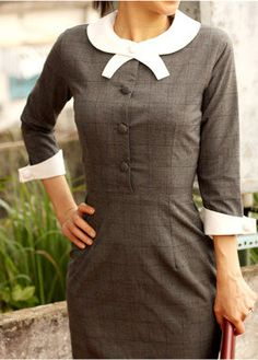 Grey dress with faint plaid with white cuffs and collar