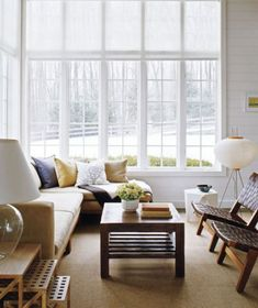 Love color scheme, chairs, and think a sectional could make a sunroom even cozier
