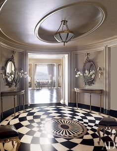 Make it bold: 11 rooms with striking black-and-white floors   archdigest.com