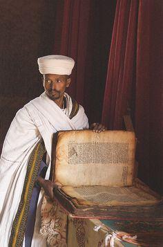 Priest with Manuscript, Lalibela, Ethiopia    In the 13th century rock-hewn Church of Bet Gabriel-Rufael