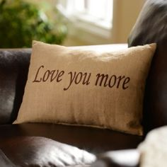 Add a rustic touch of love to your living room with our Love You More Accent Pillow! The natural burlap adds a cozy, homey feel.