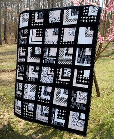 Black, white, and pink quarter log cabins quilt