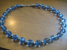 Light Sapphire Swarovski Faceted Crystal Beads with Silver Lazer Cut Spacers and Silver Hook Clasp