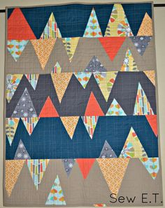 Fascinated with triangles (again) lately. Love this applique layout but would like to do something similar that's pieced rather than applique. Hmm.... Sew E.T.: Michael Miller Fabric Challenge 2014: Warp & Weft