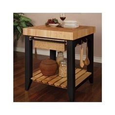 Powell Color Story Black Butcher Block Kitchen Island is a square kitchen island with butcher block top and black base. Find it at Comfort House. Butcher Block Cart, Kitchen Island With Butcher Block Top, Black Kitchen Island, Butcher Block Tables, Kitchen Island Table, Kitchen Tops, New Kitchen, Kitchen Decor, Butcher Blocks